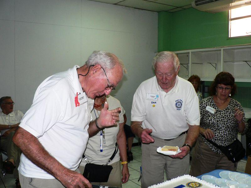 Dr. JIm cutting the cake