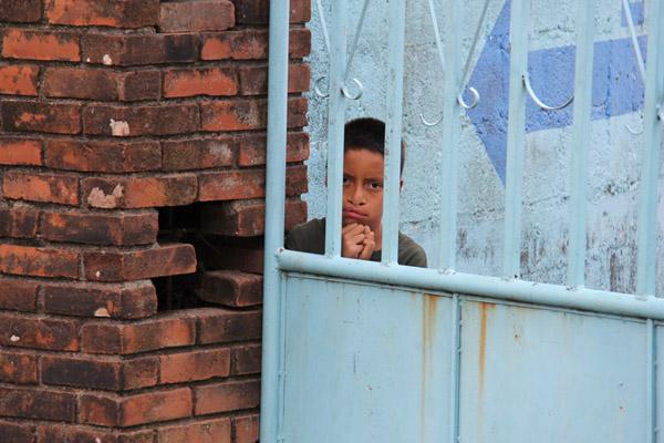 Boy through gate
