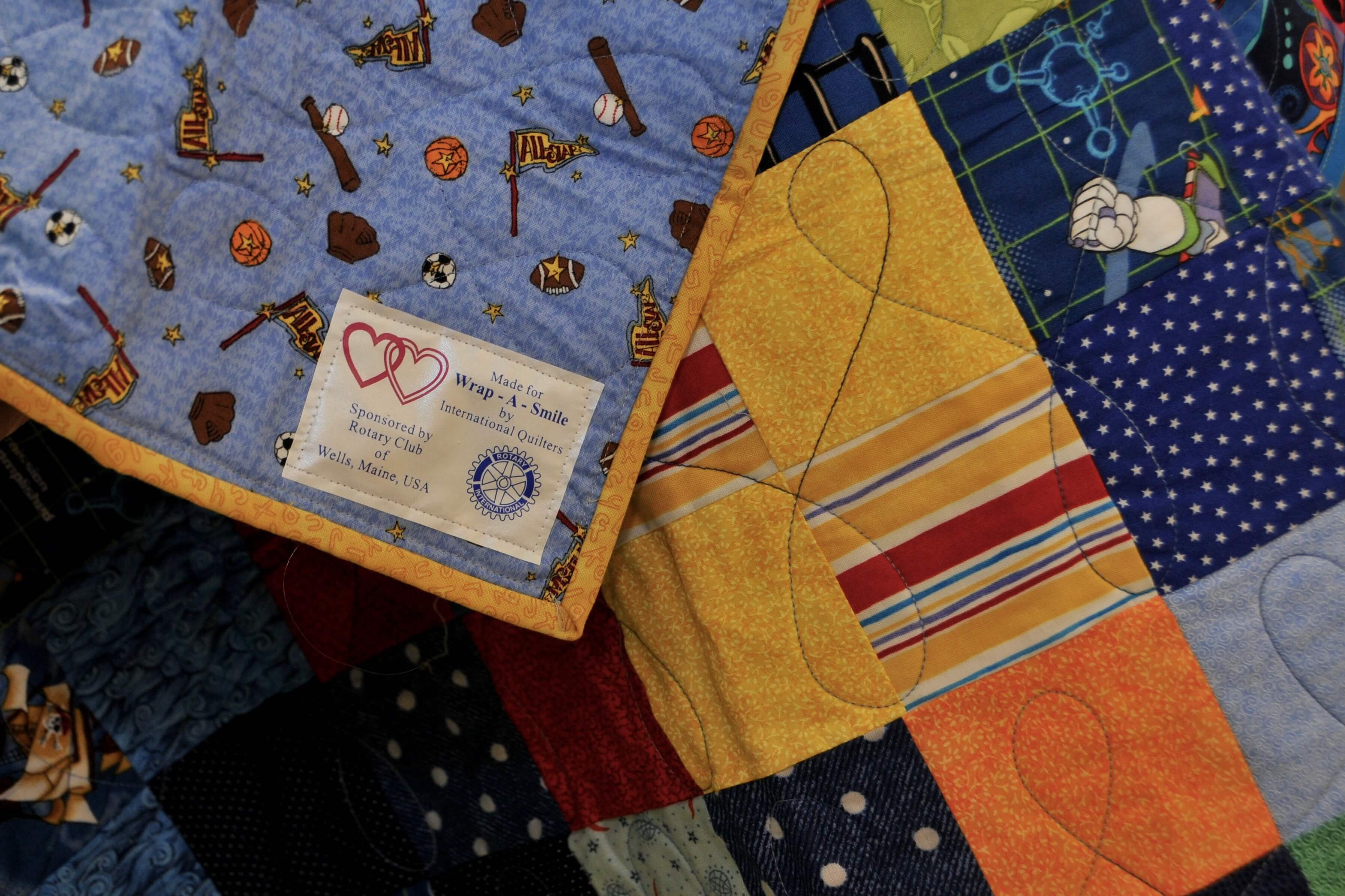 Sewing circles and Rotarians across the nation make quilts for Rotaplast patients.