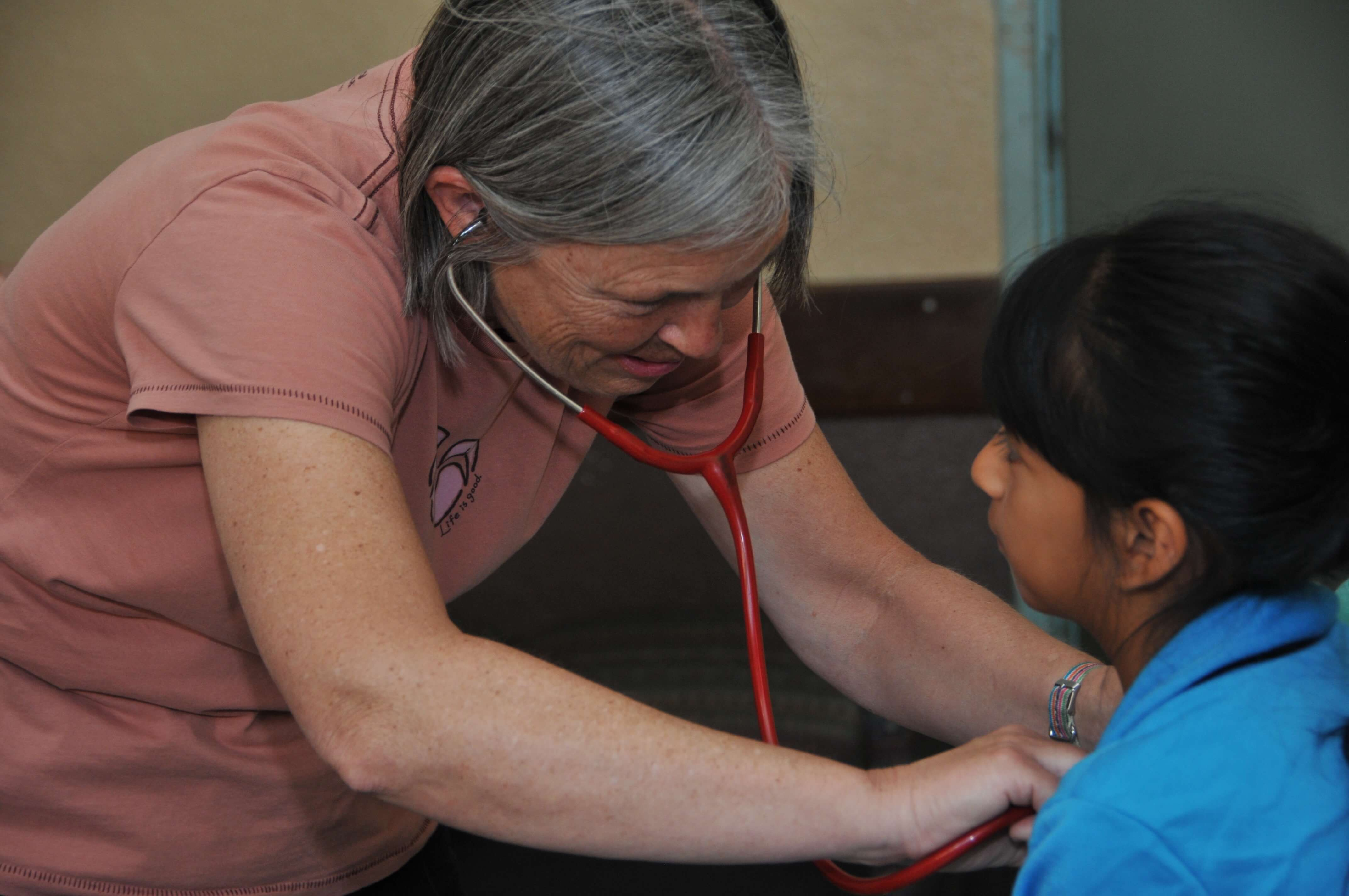 Pediatrician Paula Rand examines a potential surgery candidate and takes a detailed medical history.
