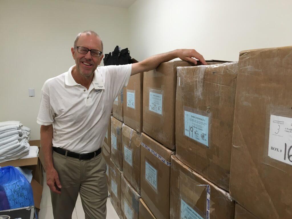 Quartermaster Steve Borkenhagen and 34 boxes of supplies.