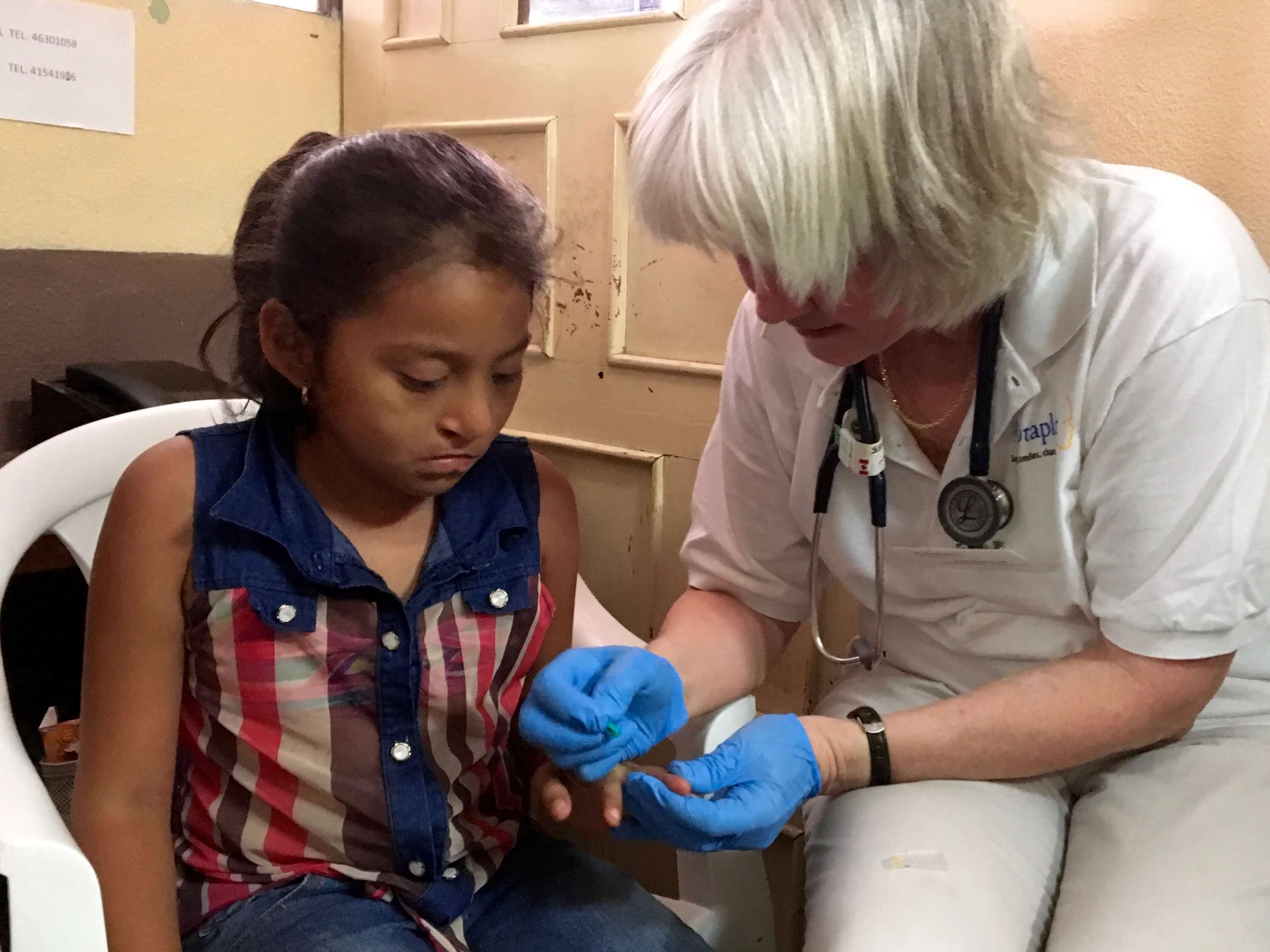 Nurse Ellen Adams checks a potential patient's vital signs and draws blood for analysis.
