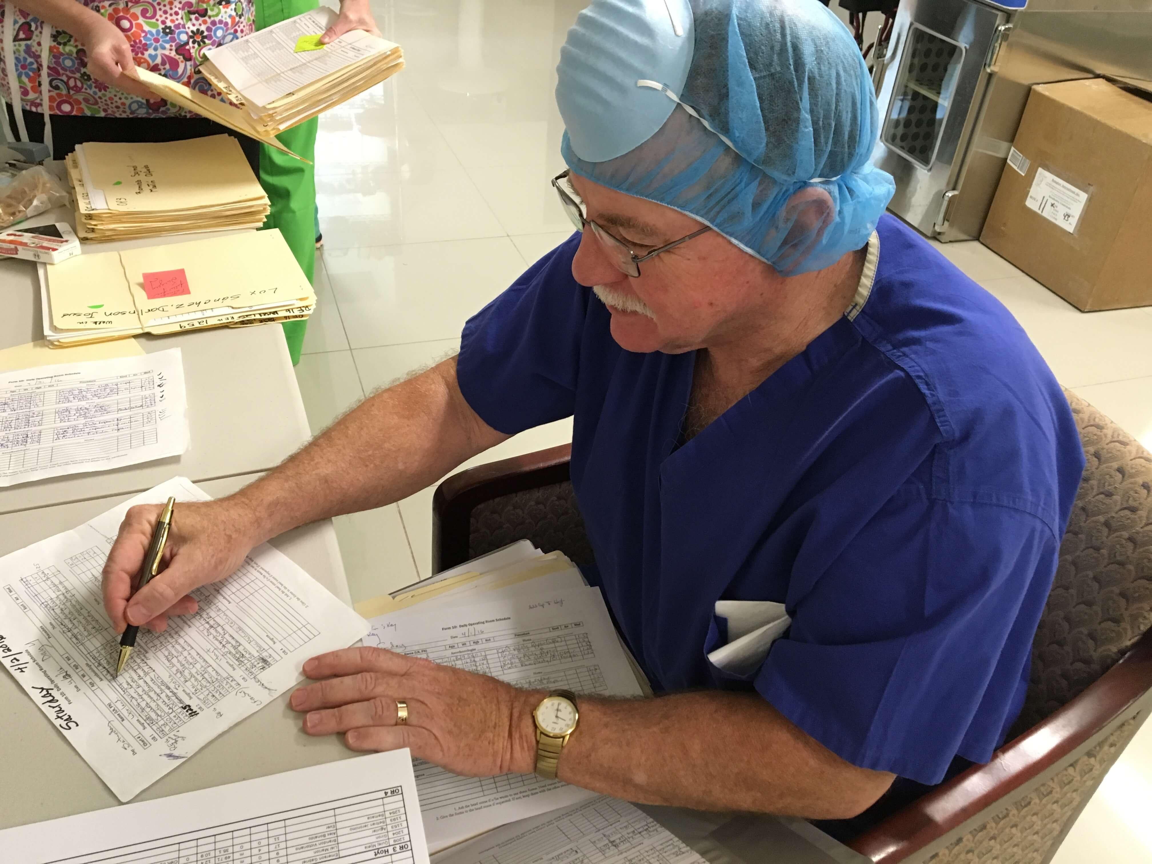 Head Nurse Jim Galloway of Scottsdale, PA, schedules surgeries.