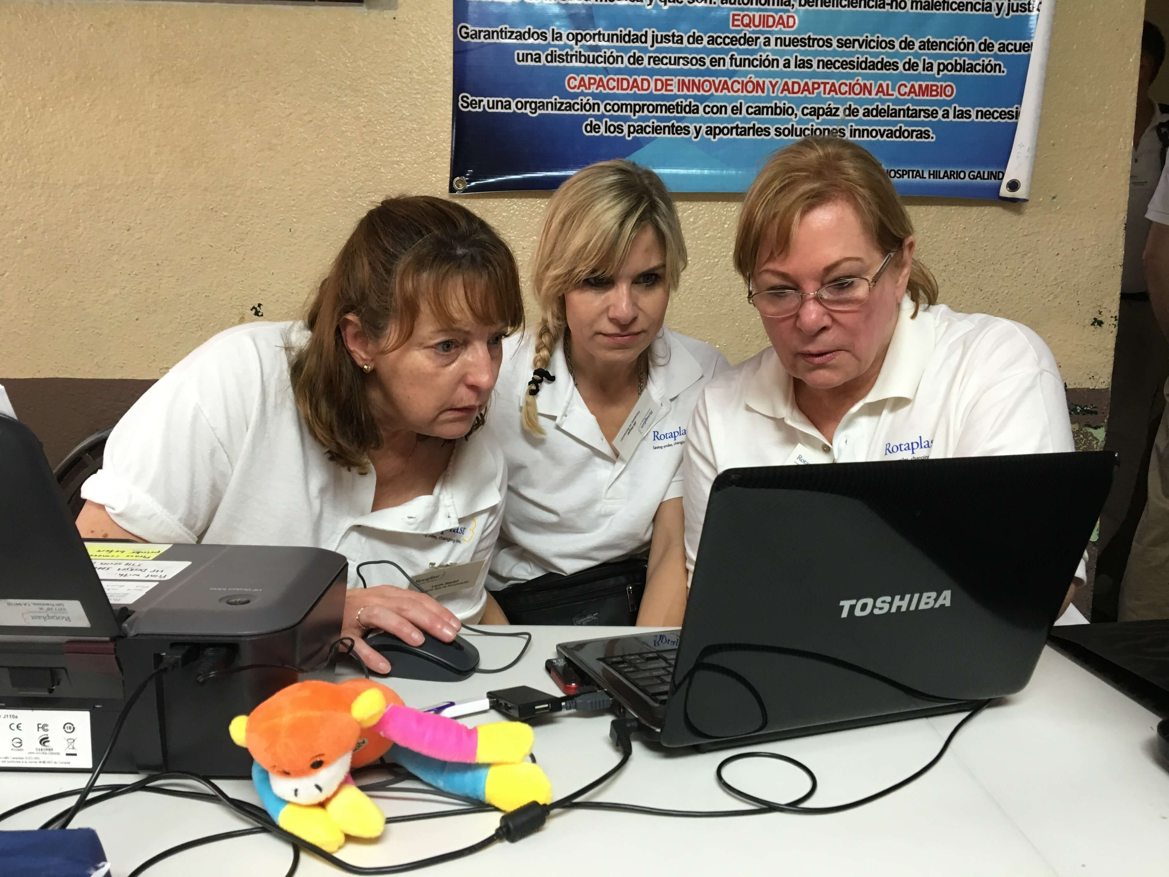 Volunteers Laurie Steckel (left), Jill Hoyer (center) and Drinda Olsen set up the registration process.