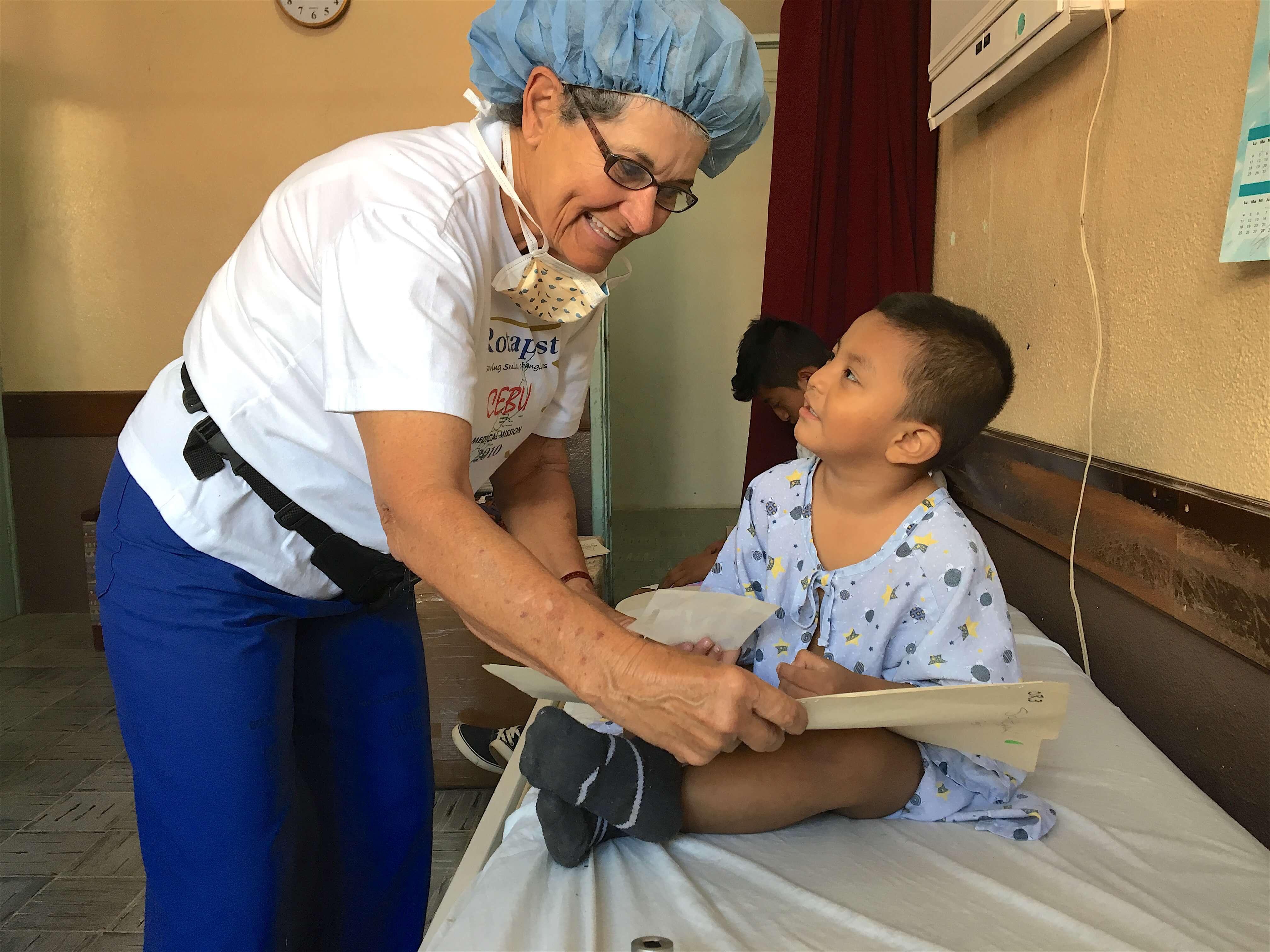 OR nurse Lois Borie examines Robin.